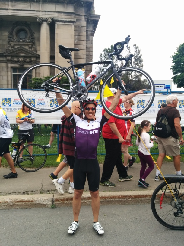 The pose that you're entitled to upon completing the Ride to Conquer Cancer!